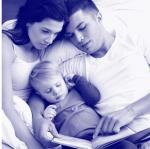 parents reading with baby